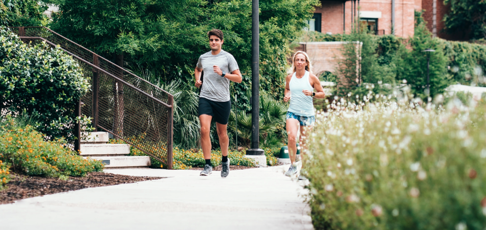 Man and woman jogging on a path in their neighbourhood