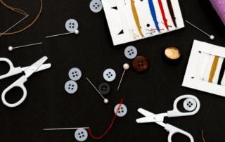 scissors, needles and thread